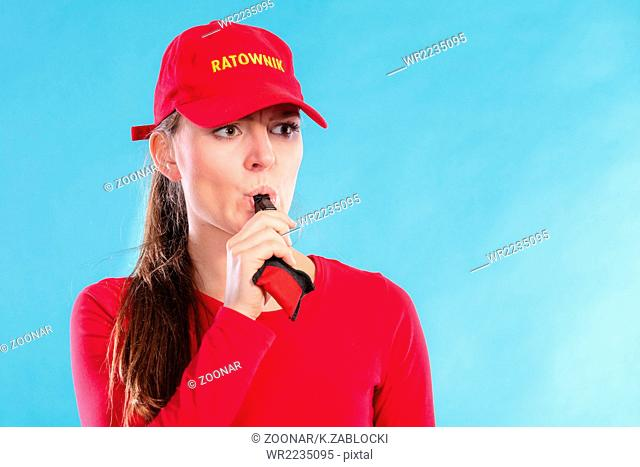 9b4cb082c1a Lifeguard woman in cap on duty blowing whistle