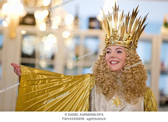 The new Nuremberg Christkind (lit. Christ Child), Barbara Otto, poses in her official garments during a fitting in Nuremberg, Germany, 10 November 2015