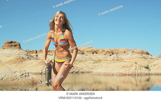 woman in a bikini flexing