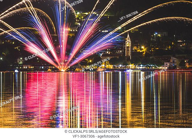Fireworks at Pusiano lake with the Pusiano church, brianza, province of como, Lombardy, italy