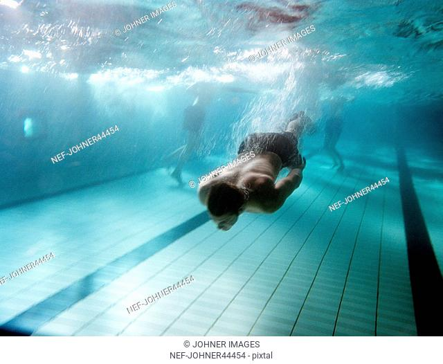 A man swimming under water