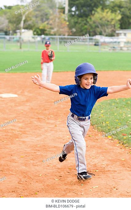 Hispanic boys playing baseball