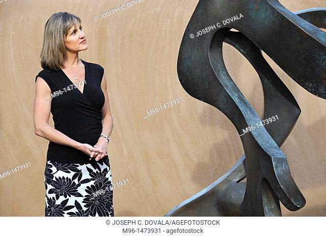 Woman looking at sculpture, Santa Fe, New Mexico, USA