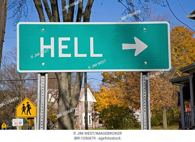 A road sign points towards the small town of Hell, Gregory, Michigan, USA