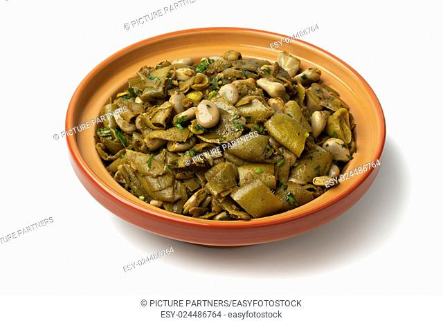 Dish with traditional Moroccan steamed broad beans and pods on white background