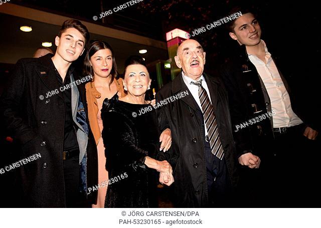 Ben Brauner (L-R) and companion, Maria Brauner, Artur Brauner and David Brauner arrive for the premiere of the film 'Auf das Leben' in Berlin, 29 October 2014