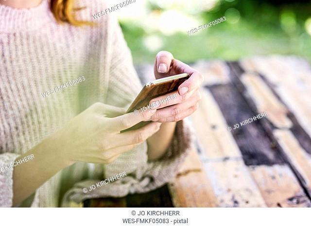 Woman's hands text messaging