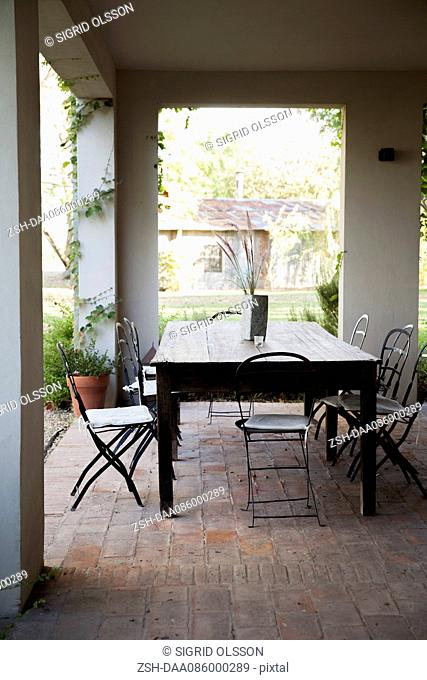 Table and chairs set on veranda