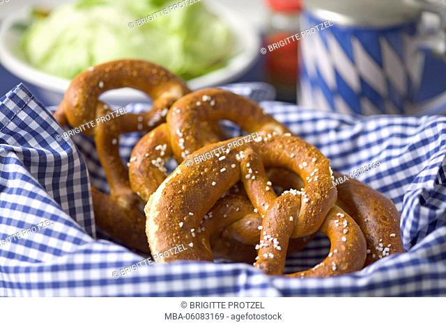 pretzeln in basket on blue-white napkin