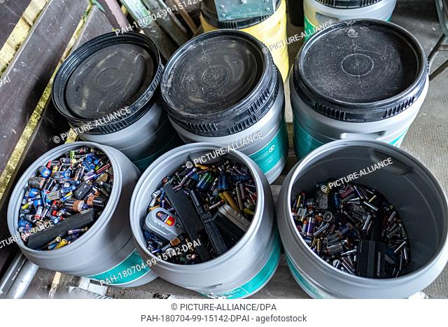 19 June 2018, Hanover, Germany: Batteries are in a disposal bin at a recycling center in Hanover. Whether button cell from the hearing aid or alkaline-manganese...