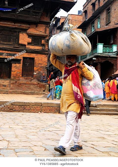 homeless man with his belongings , the nepalis , life in kathmandu , kathmandu street life , nepal
