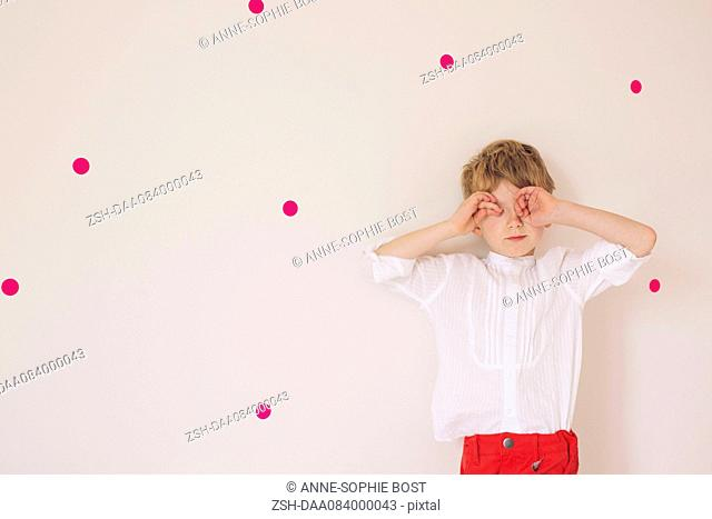 Little boy covering eyes with his hands, portrait