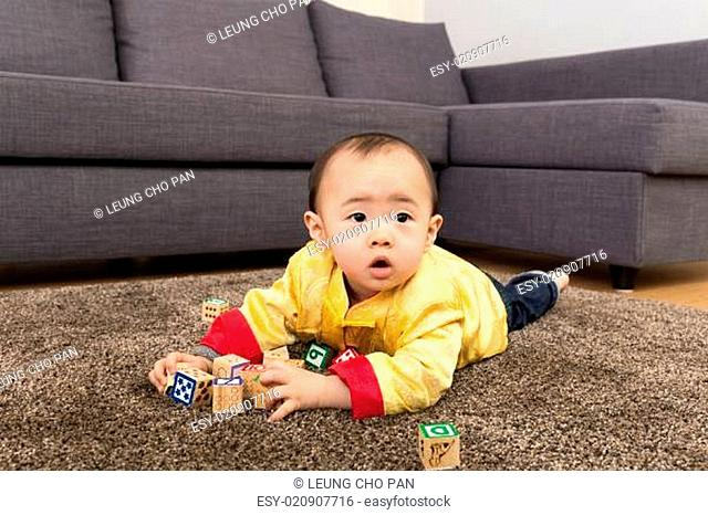 Chinese baby boy play toy block at home