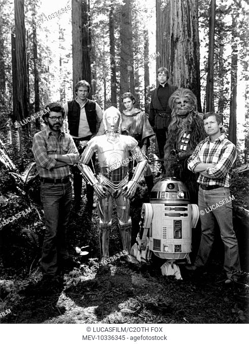 STAR WARS: EPISODE VI - RETURN OF THE JEDI [US 1983] [L-R] Executive Producer GEORGE LUCAS, HARRISON FORD, ANTHONY DANIELS as 'C-3P0', CARRIE FISHER
