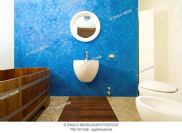 Italy, home interior, bathroom with wood and stone platform