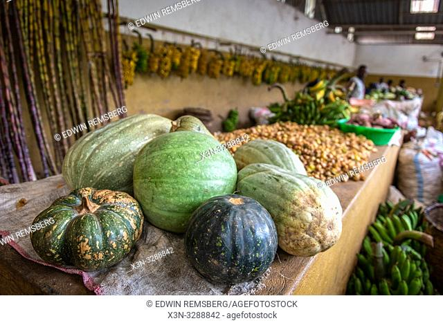 Various squash sitting out for sale at outdoor market, Rwanda Farmers Market, in Rwanda