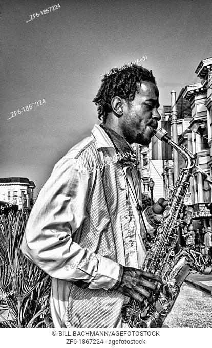Black man playing sax in Gay Pride Weekend Pink Celebration in the gay Castro District of San Francisco California