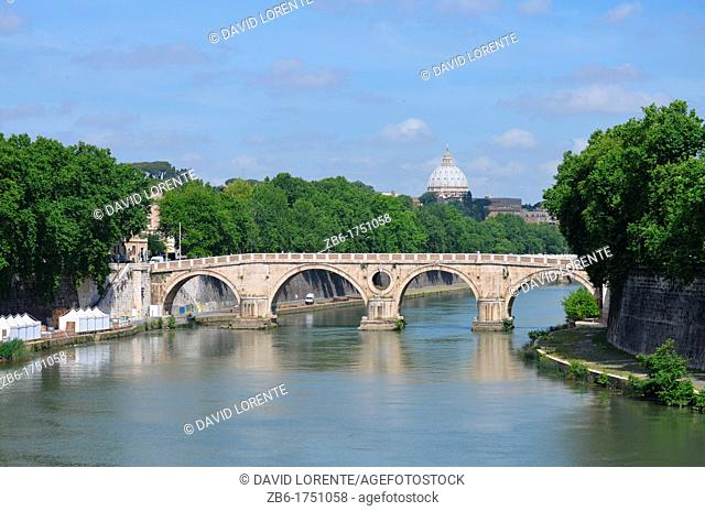 View of the Tiber River and the dome of St. Peter