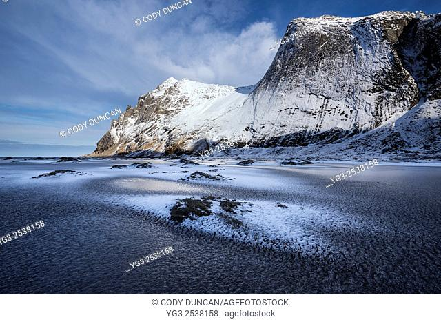 Frozen sand of Bunes beach in winter, Moskenesøy, Lofoten Islands, Norway
