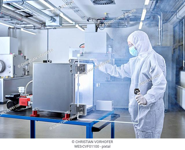 Chemist working in industrial laboratory clean room