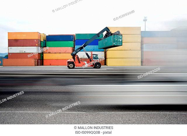 Truck lifting shipping containers
