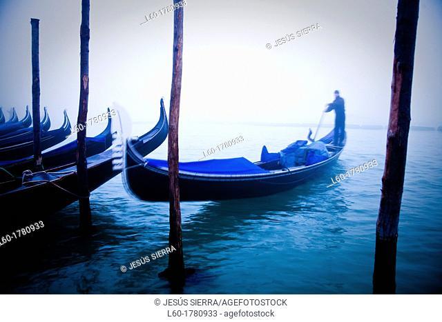 Gondolier in Venice, Veneto, Italy