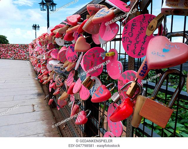 Pink love locks on a fence on Penang Hill