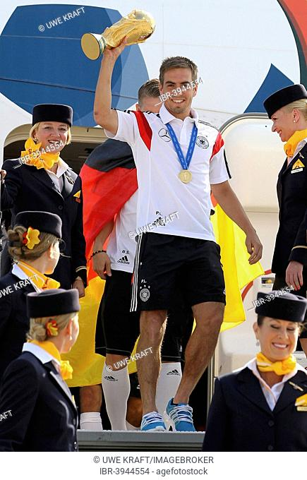 Philipp Lahm with the trophy,arrival of the German national team after their victory at the FIFA World Cup 2014 at Tegel, Berlin, Germany Airport