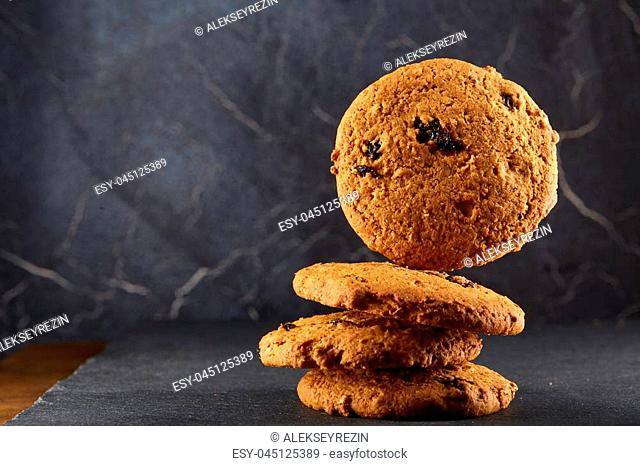 Freshly baked chocolate chips cookies isolated on black background, macro, close-up, shallow depth of field, selective focus