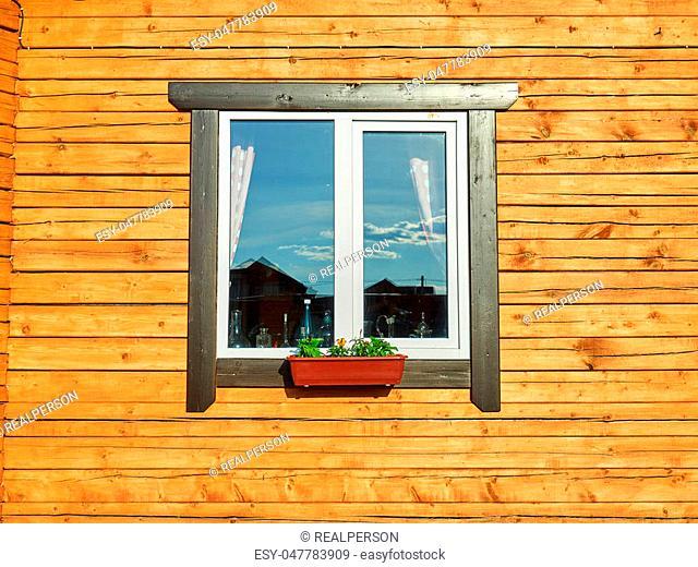 Cute window on yellow house wall