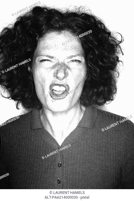 Woman snarling, portrait, b&w