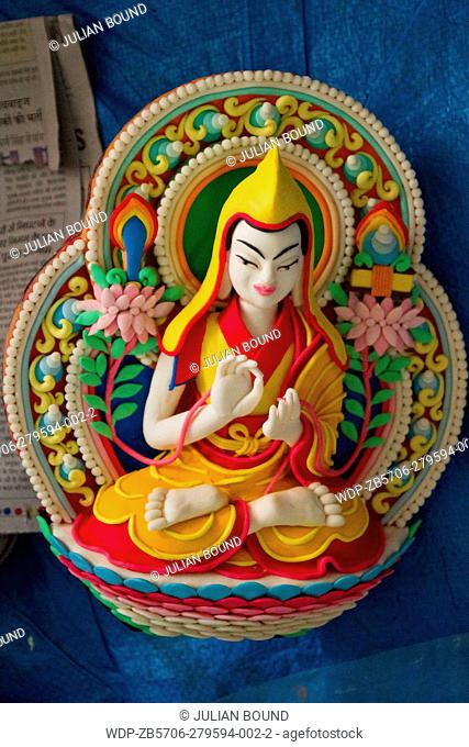 Tibetan Buddhist monks sculpt Buddhist designs and figures from coloured butter for 'Losar' the Tibetan New Year at the Dalai Lama temple, McLeod Ganj, India
