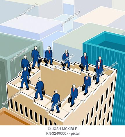 Businessman walking up and down on stairs on rooftop