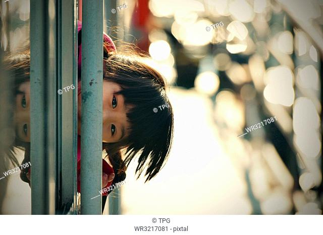 Little Girl looking out of the window;China
