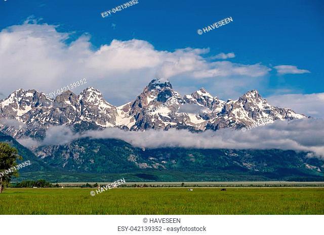 Grand Teton Mountains with low clouds. Grand Teton National Park, Wyoming, USA