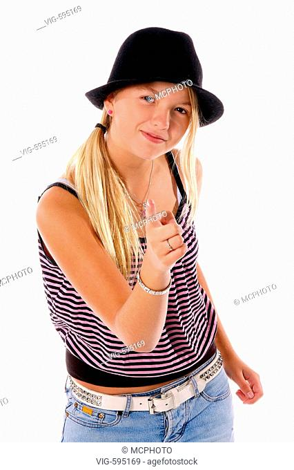 Young girl in cute cloths and a black felt hat pointing mischievously at the camera  - 18/12/2007