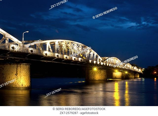 Illuminated Trang Tien Bridge over Perfume River, Hue, Vietnam. Bridge lit up at dusk, Trang Tien Bridge, Perfume River, Hue, Vietnam