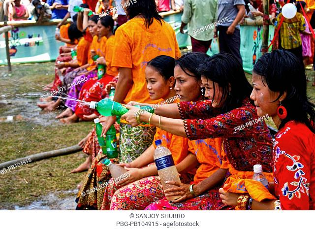 The Water Festival of the ethnic Rakhain community is a part of their New Year celebration Young boys and girls throw water at each other during this festival...