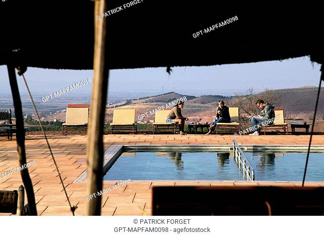 VACATIONERS BY THE POOL FOR THE ECOLODGES, DOMAINE DE TERRES D'AMANAR, TAHANAOUTE, AL HAOUZ, MOROCCO