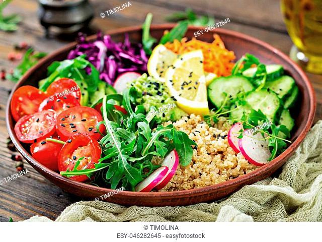 Vegetarian Buddha bowl with quinoa and fresh vegetables. Healthy food concept. Vegan salad
