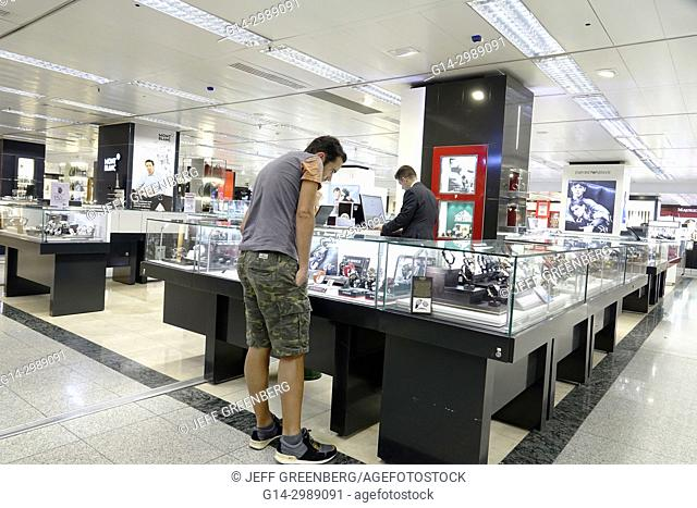 Portugal, Lisbon, El Corte Ingles, Spanish department store, shopping, jewelry, display case, watches, Hispanic, man, salesman, looking