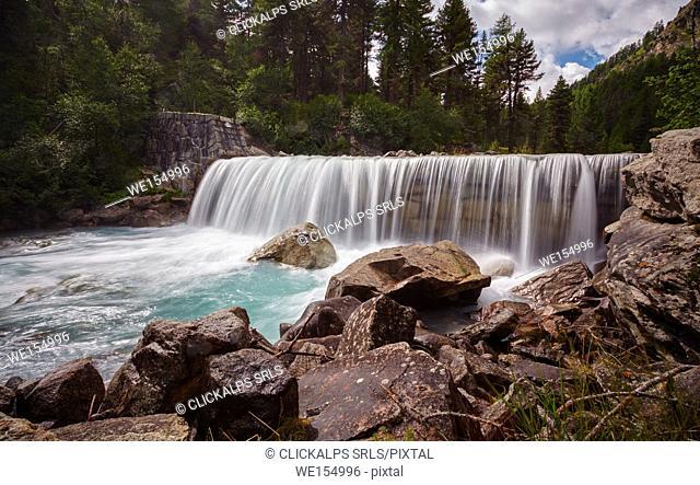 Roseg Valley, Pontresina, Grigioni, Switzerland. Waterfall along the pathway
