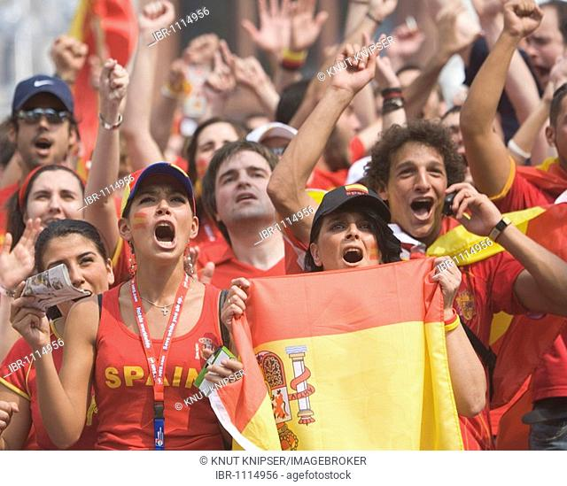 During the Football World Cup 2006 Spanish football fans celebrate a goal of their team on the Friedensplatz, where the matches are transmitted on a large...