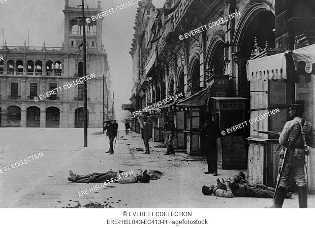 Soldier on alert among dead bodies in Mexico City, Feb. 1913. Probably during the Ten Tragic Days of the overthrow and murder of President Madero...