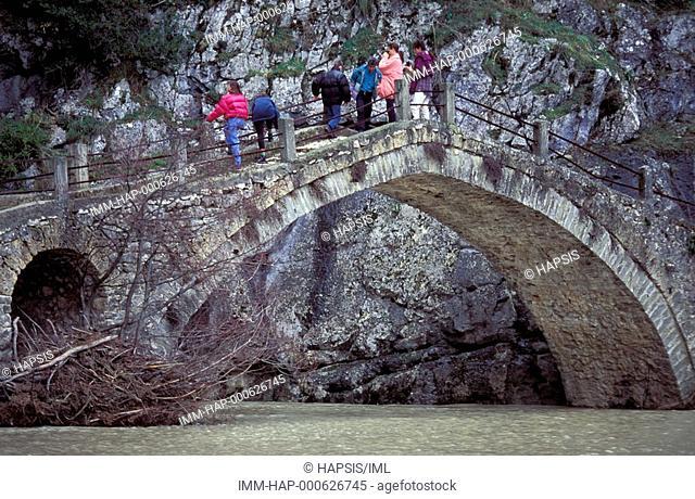 Tourists standing on bridge, Grevena, Macedonia West, Greece
