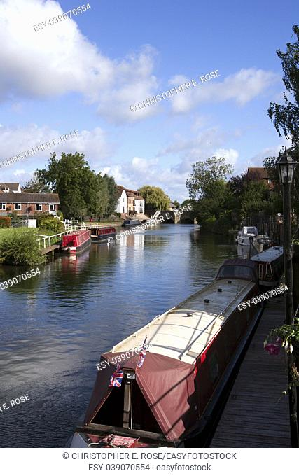 Canal boats moored on the Avon Navigation near the centre of the town of Tewkesbury, Gloucestershire, UK