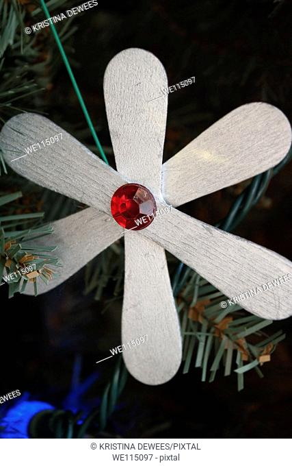 A homemade ornament created from popsicle sticks