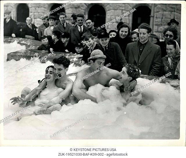 Oct. 30, 1952 - Bubble Bathers Halt Traffic Police Take Names: Bubbles burst against the nearby windows of the Lord Mayor's parlour