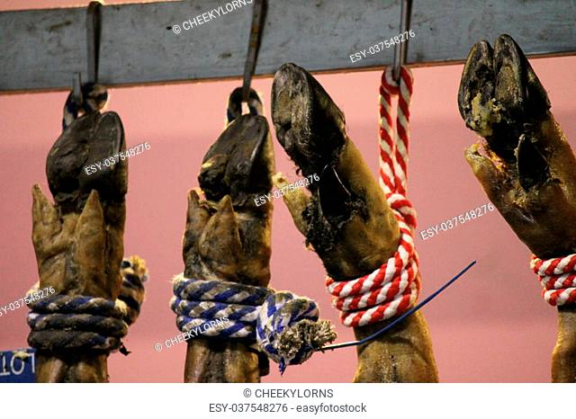 serrano ham with hooves hanging up jamon