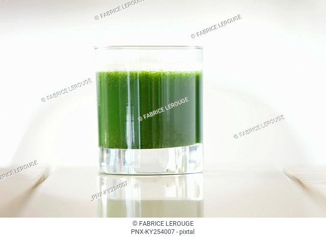 Close-up of a glass of pea soup